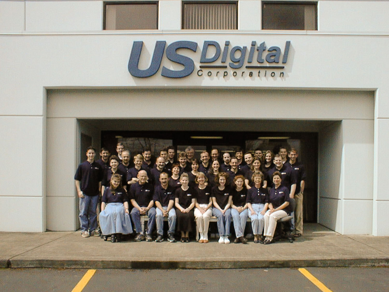 US Digital employees pose for a portrait outside the companys old building in Vancouver ahead of the 20 year anniversary in May 2000.