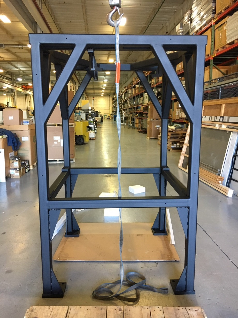 The frame, after welding and powder coating but before components were installed. At more than 800 pounds, its mass stabilizes the system during robot motions—a key requirement for positioning accuracy.