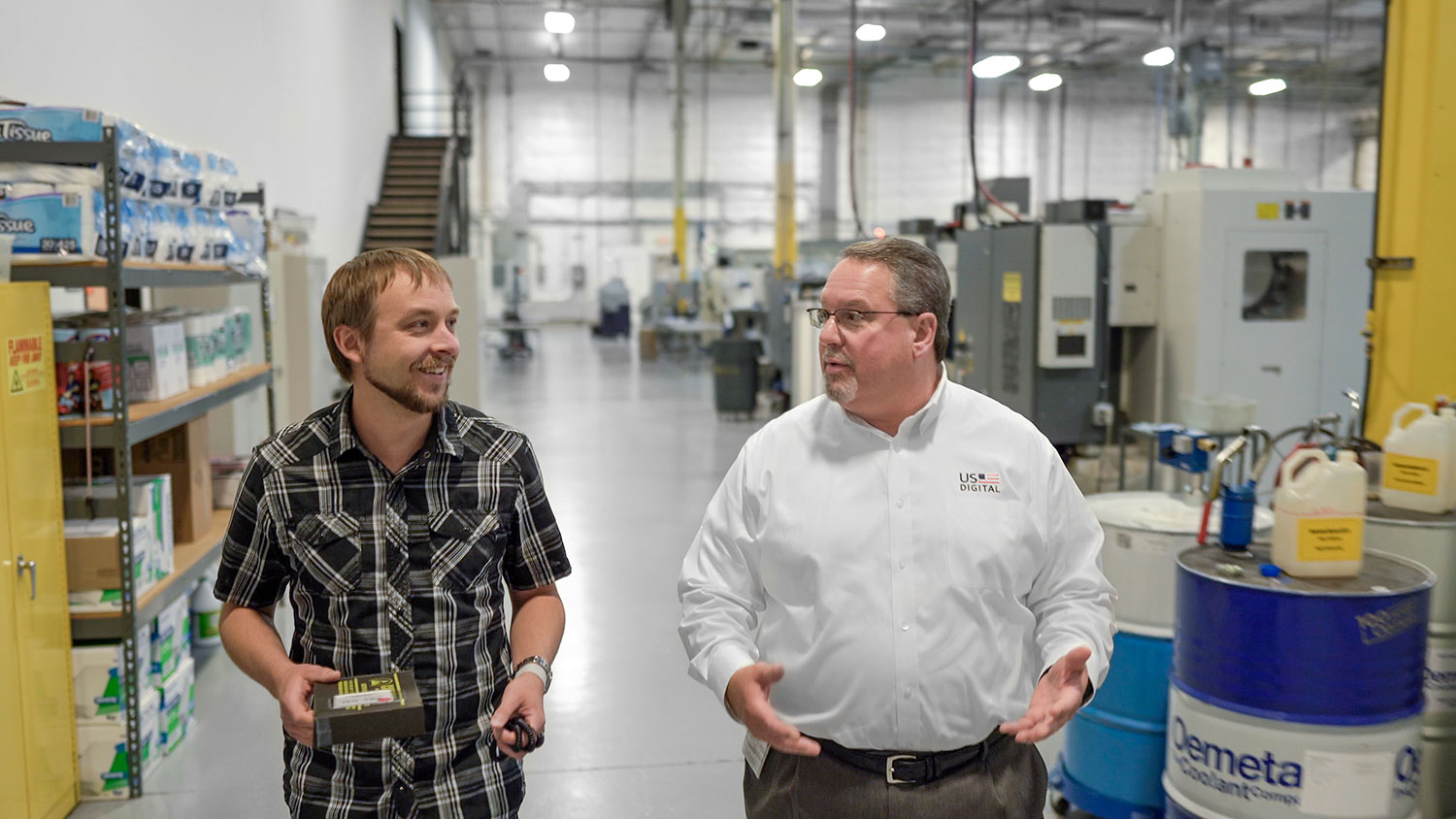 US Digital COO Neal Donowitz, right, and Technical Support Quality Representative Josh Morris discuss a product return in the US Digital plant.